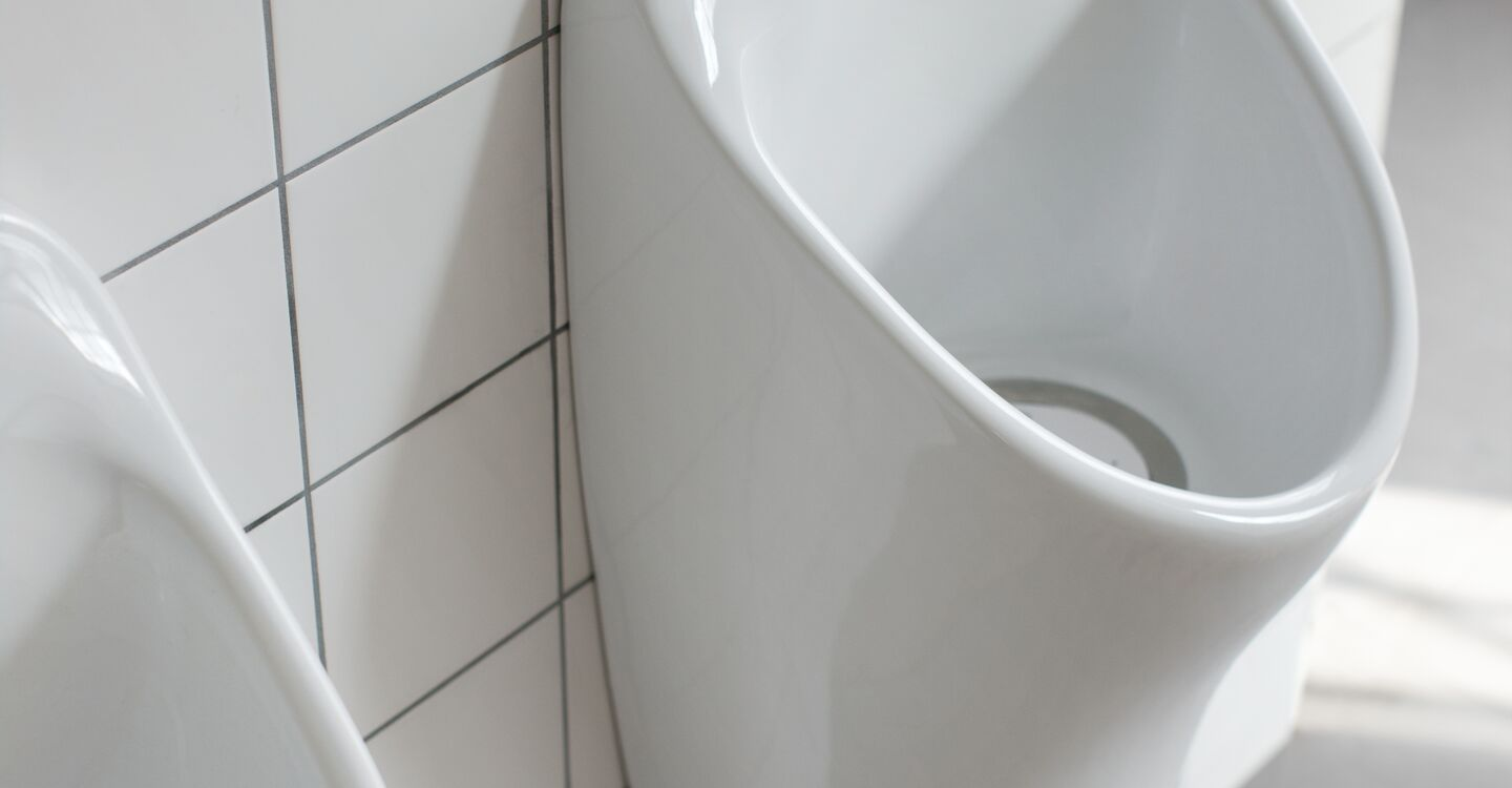 Stainless steel slab urinal up to 305cm long